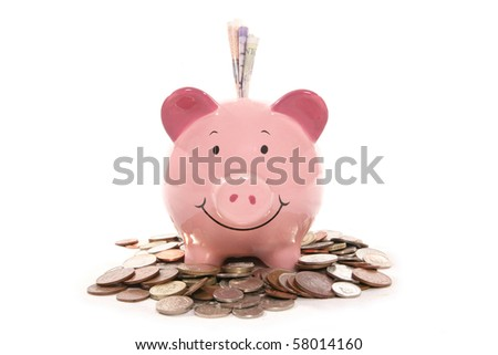 piggy bank moneybox with British currency money - stock photo