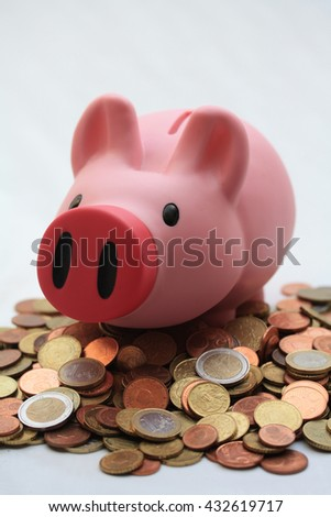 Piggy bank on a pile of euro coins