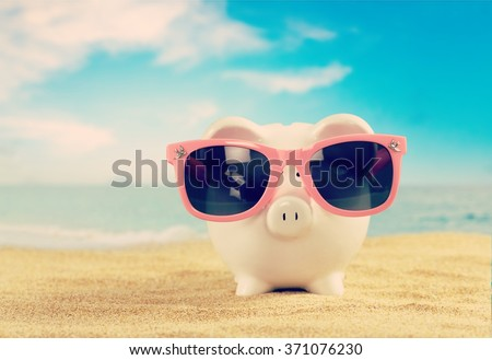 Piggy Bank on beach. - stock photo