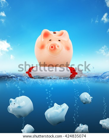 Piggy bank on buoy floating on water with sinking piggy banks - stock photo