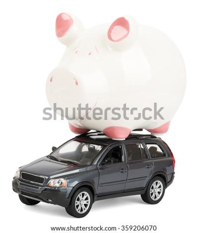 Piggy bank on car - stock photo