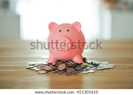 Piggy bank on coin stack, time and money concept. - stock photo