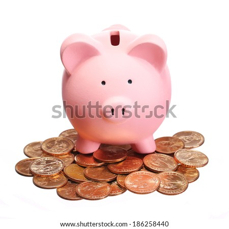 Piggy Bank on Gold Coins isolated on white. Money - stock photo
