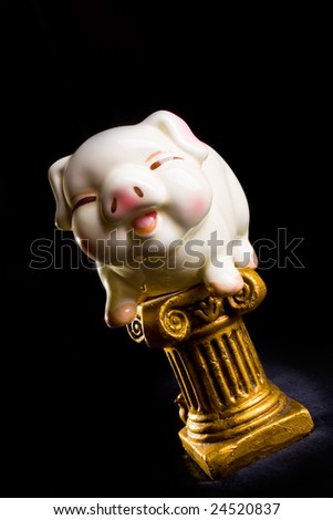 Piggy bank on gold pillar - stock photo