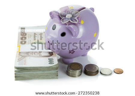 piggy bank on money isolated on white background.