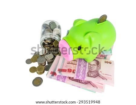 piggy bank on money isolated on white background  - stock photo