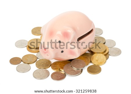 Piggy bank on money on isolated white background
