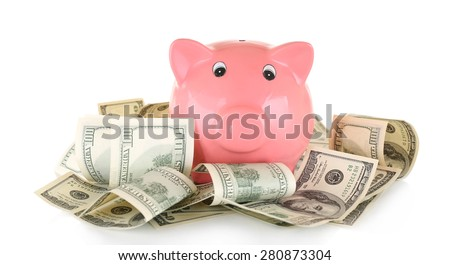 Piggy bank on pile of dollars isolated on white - stock photo