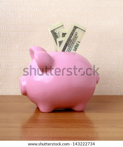 piggy bank on the desk - stock photo