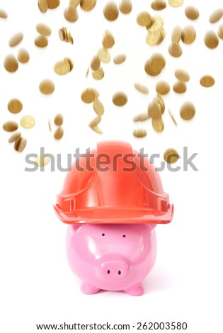 Piggy Bank on White Background with hard hat protecting him from falling money - stock photo