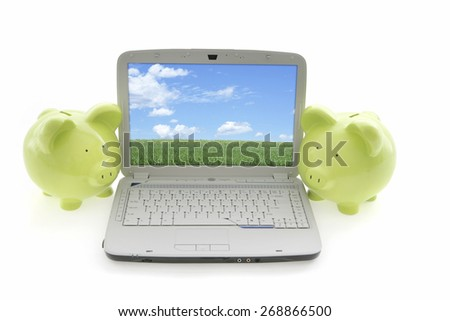 Piggy Bank on White Background with laptop - stock photo