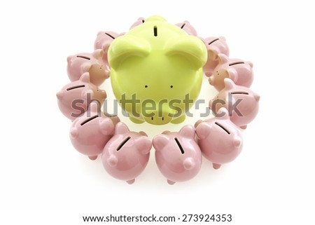 piggy bank on white background with small piggy banks all around