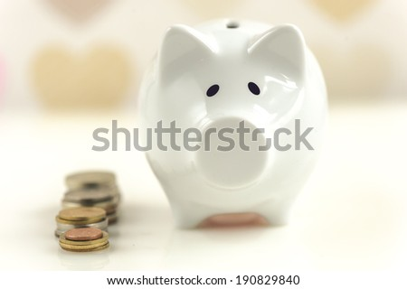 Piggy bank over heart cover wall paper - stock photo