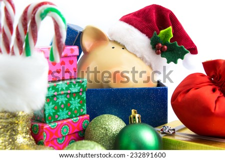 Piggy bank Santa with ornaments isolated on white  - stock photo
