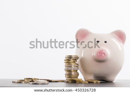 Piggy bank saving with your money stack coin white background. - stock photo