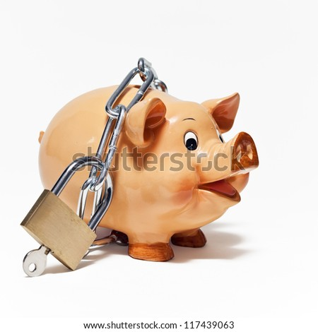 Piggy bank secured with padlock on white background.