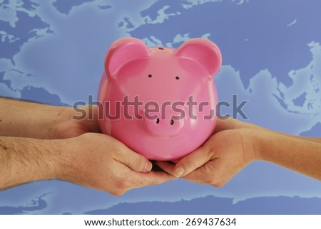 Piggy Bank sharing in front of map - stock photo