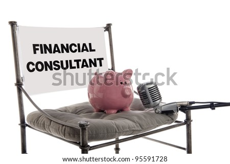 Piggy bank sits in the guest chair as a financial consultant with a microphone, isolated on white - stock photo