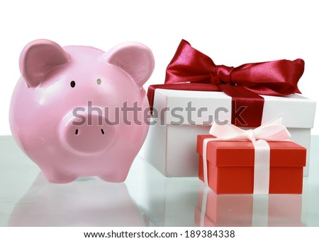 Piggy bank style money box and gift isolated on a white background. - stock photo
