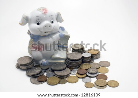 Piggy bank swine. Coin pile isolated on white background.