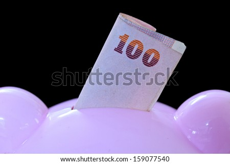 Piggy bank, thai banknotes,saving money - stock photo