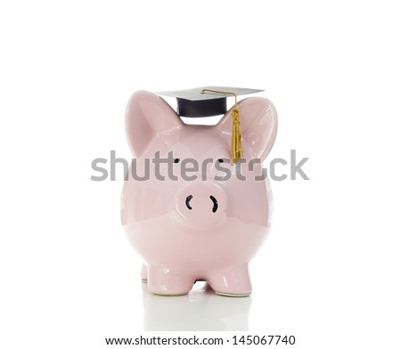piggy bank wearing a graduation cap, on white - stock photo