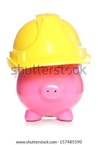 Piggy bank wearing a hard hat cutout - stock photo