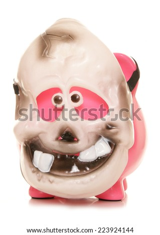 Piggy bank wearing a skeleton halloween mask cutout