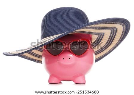 piggy bank wearing a sun hat and sunglasses cutout - stock photo