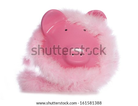 Piggy bank wearing fluffy garland studio cutout - stock photo