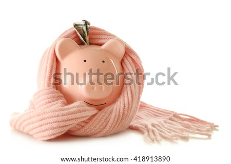 Piggy bank wearing scarf, isolated on white. Saving heating concept - stock photo