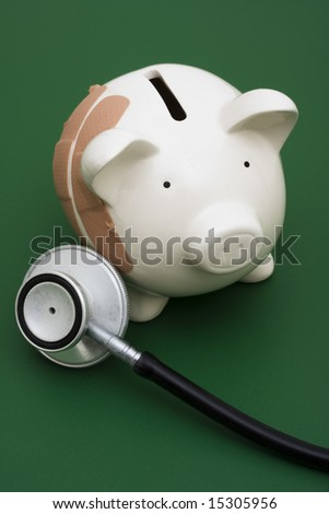 Piggy bank with adhesive bandage, the health of your finances