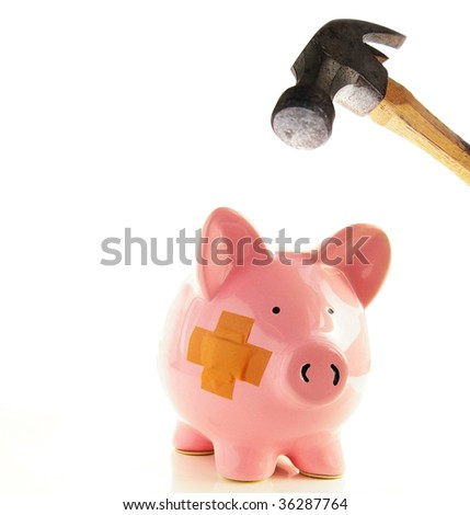 Piggy bank with bandage about to be smashed by a hammer, metaphor for healthcare costs - stock photo