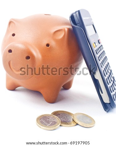 Piggy bank with calculator and coins - stock photo