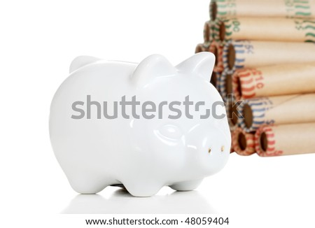 piggy bank with coin rolls