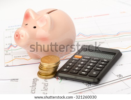 Piggy bank with coins and calculator on business documents background