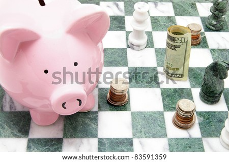 piggy bank with coins and chess pieces
