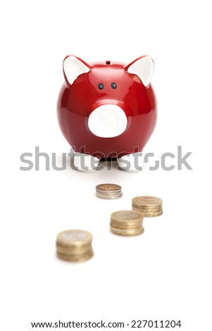 Piggy Bank with Coins on the white background. Isolated on white - stock photo