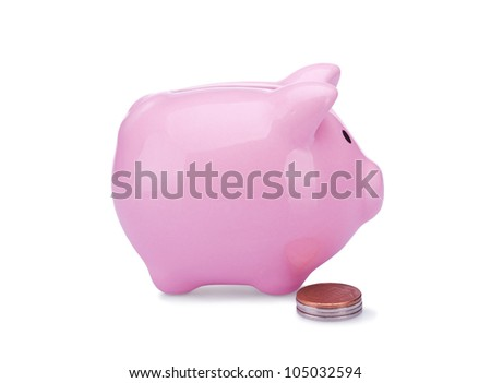 piggy bank with copper and silver coins isolated on white background