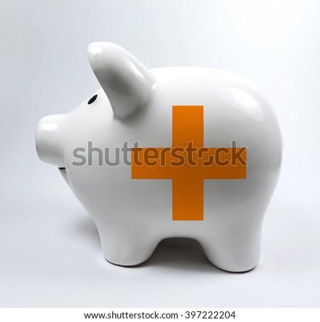 Piggy bank with cross symbol   - stock photo