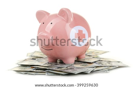 Piggy bank with dollars isolated on white - stock photo