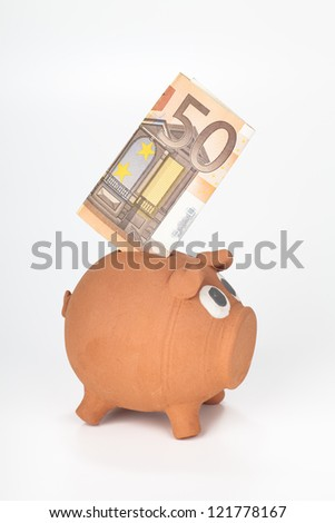 Piggy bank with 50 euro banknote