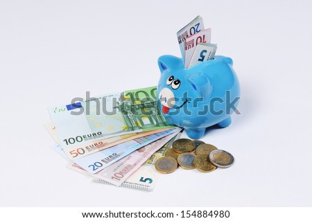 Piggy bank with Euro bills and Euro Coins - stock photo