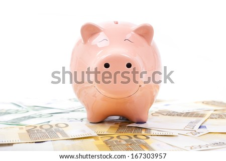 Piggy bank with euro bills isolated on white background