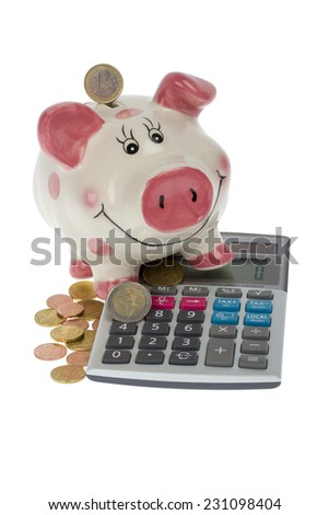 Piggy bank with euro coins and calculator on white background - stock photo