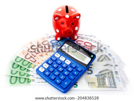 Piggy bank with euro money and calculator - stock photo