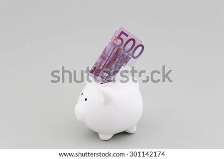 Piggy Bank With 500 Euros - stock photo