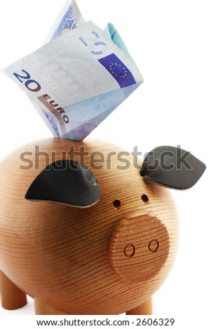 Piggy bank with 20 euros note isolated on white background - stock photo