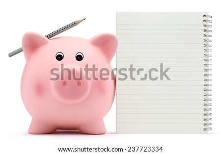 piggy bank with exercise book and pencil on white background - stock photo