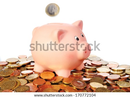 piggy bank with falling Euro Coin in a area from Euro Coins with white background
